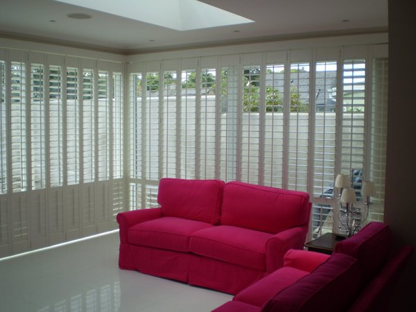 STUNNING SHUTTERS IN A SUNROOM BY ADARESHUTTERS