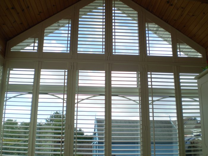 Stunning arched window shutters supplied and fitted by adareshutters
