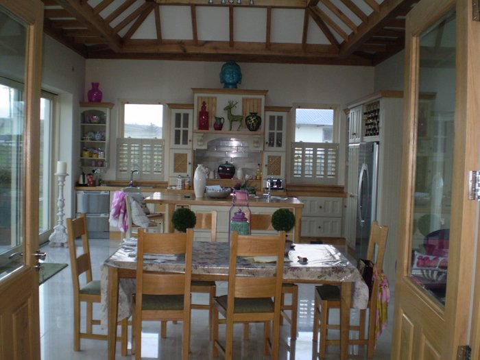 Cafe style shutters in a kitchen by adareshutters