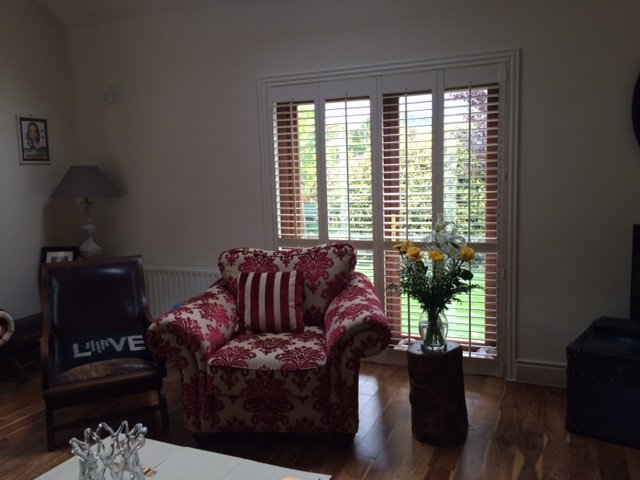 These shutters add a touch of class to this already beautiful room